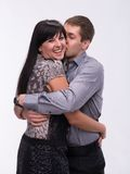 Man kissing his smiling girlfriend Stock Photography