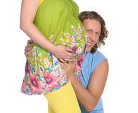 Man embracing pregnant belly 2 Stock Photos