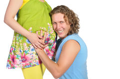 Man embracing pregnant belly Stock Photography