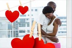 Man embracing pregnant woman Stock Images
