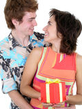 Man embracing woman as she holds present Stock Photos