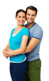 Man Embracing Woman From Behind Against White Background Royalty Free Stock Photos