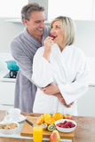 Man embracing a woman from behind in kitchen Royalty Free Stock Photo