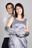 Man embracing woman in evening dress from back Royalty Free Stock Image