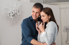 Man Embracing Woman Front Of The Window Stock Photo