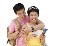Man embracing woman with leaflet, smiling, close-up, cut out Stock Images