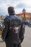 Man with embroidery on a leather motorbike jacket, Podebrady castle on back royalty free stock photography