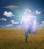 Man Emerge. S from doorway in landscape accompained by alien craft Royalty Free Stock Photos