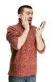 Man emotionally reading MMS sms on your mobile phone Royalty Free Stock Images
