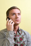 Man emotions 7. Young man listening his friend by mobile and looking upward Stock Image