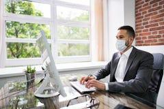 Man Employee In Office Wearing Face Mask Working