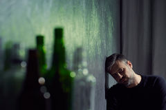 Man with empty alcohol bottles Stock Photo
