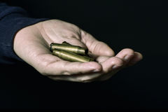 Man with empty bullets in his hand Royalty Free Stock Photo