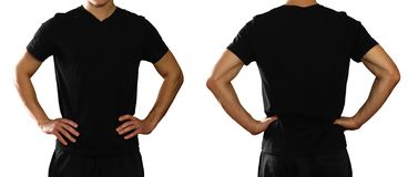 A man in an empty clean black t-shirt. on grey backgrou. Nd stock image