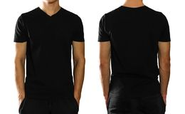 A man in an empty clean black t-shirt. Isolated on white background. stock photography