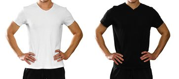 A man in an empty clean white and black t-shirt. Front view. Iso. A man in an empty clean white and black t-shirt. Front view. on white background stock photos