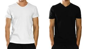 A man in an empty clean white and black t-shirt. Front view. Iso. A man in an empty clean white and black t-shirt. Front view. on white background royalty free stock images