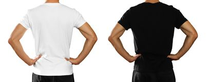 A man in an empty clean white and black t-shirt. Rear view. Isolated on white background stock images