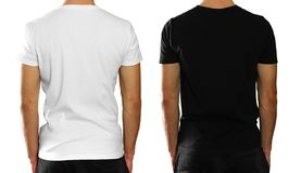 A man in an empty clean white and black t-shirt. Rear view. Isolated on white background. A man in an empty clean white and black t-shirt. Rear view. on white stock photography