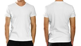 A man in an empty clean white t-shirt. on grey backgrou. Nd stock photos