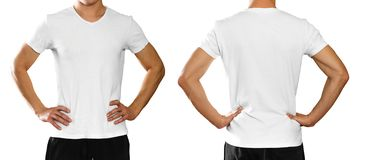 A man in an empty clean white t-shirt. on white backgro. Und stock photo