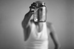Man with  empty jar Stock Photography