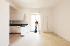 Man in empty kitchen Stock Image