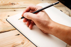 A man with an empty notebook. Stock Photo
