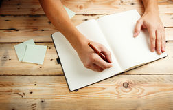 A man with an empty notebook. Royalty Free Stock Image