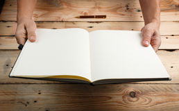 A man with an empty notebook. Stock Image