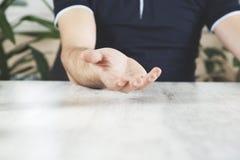 Man empty palm on desk stock photo