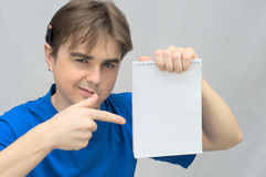 Man with empty paper of notebook Royalty Free Stock Photos