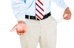 Man with empty pocket. Half-portrait of man pulling out empty pocket with one hand and asking for money with the other, isolated on white background Stock Images
