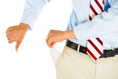 Man with empty pocket and thumbs down Royalty Free Stock Photo
