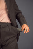 Man with empty pocket of trousers Royalty Free Stock Photography