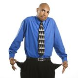 Man with empty pockets. Stock Image