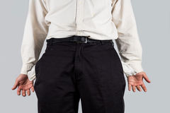 Man with empty pockets gestures with his hands Stock Image