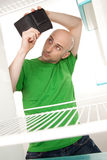 Man and empty refrigerator Stock Photography