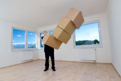 Man in empty room with boxes Stock Photography