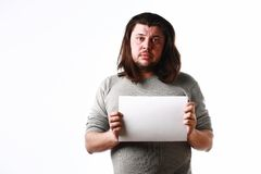Man with empty sheet of paper Stock Photography