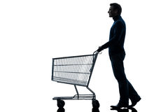 Man with empty shopping cart silhouette Stock Photos