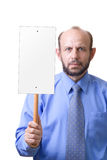 Man with an empty sign. Senior man holding an empty sign, focused on hand with a sign Royalty Free Stock Photography