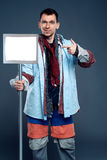 Man with empty sign in hand, clothing sale concept Stock Images