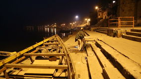 Man at empty stairs of Ganges river in Varanasi in the night time. VARANASI, INDIA - 22 FEBRUARY 2015: Man at empty stairs of Ganges river in Varanasi in the stock video