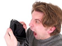 Man with an empty wallet. A man with an empty wallet isolated on a white background Stock Images