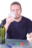 Man with an Empty Whiskey Bottle on a Poker Table Stock Photos