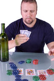 Man with an Empty Whiskey Bottle on a Poker Table Stock Images