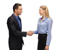 Man en vrouw die hun handen schudden Stock Afbeelding