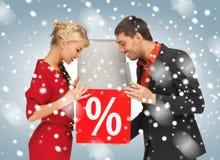 Man en vrouw met percententeken Royalty-vrije Stock Afbeeldingen