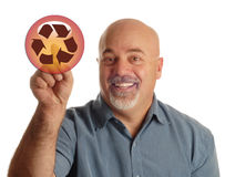 Man encouraging recycling. Bald man pointing at icon indicating recycle - please recycle Royalty Free Stock Photo
